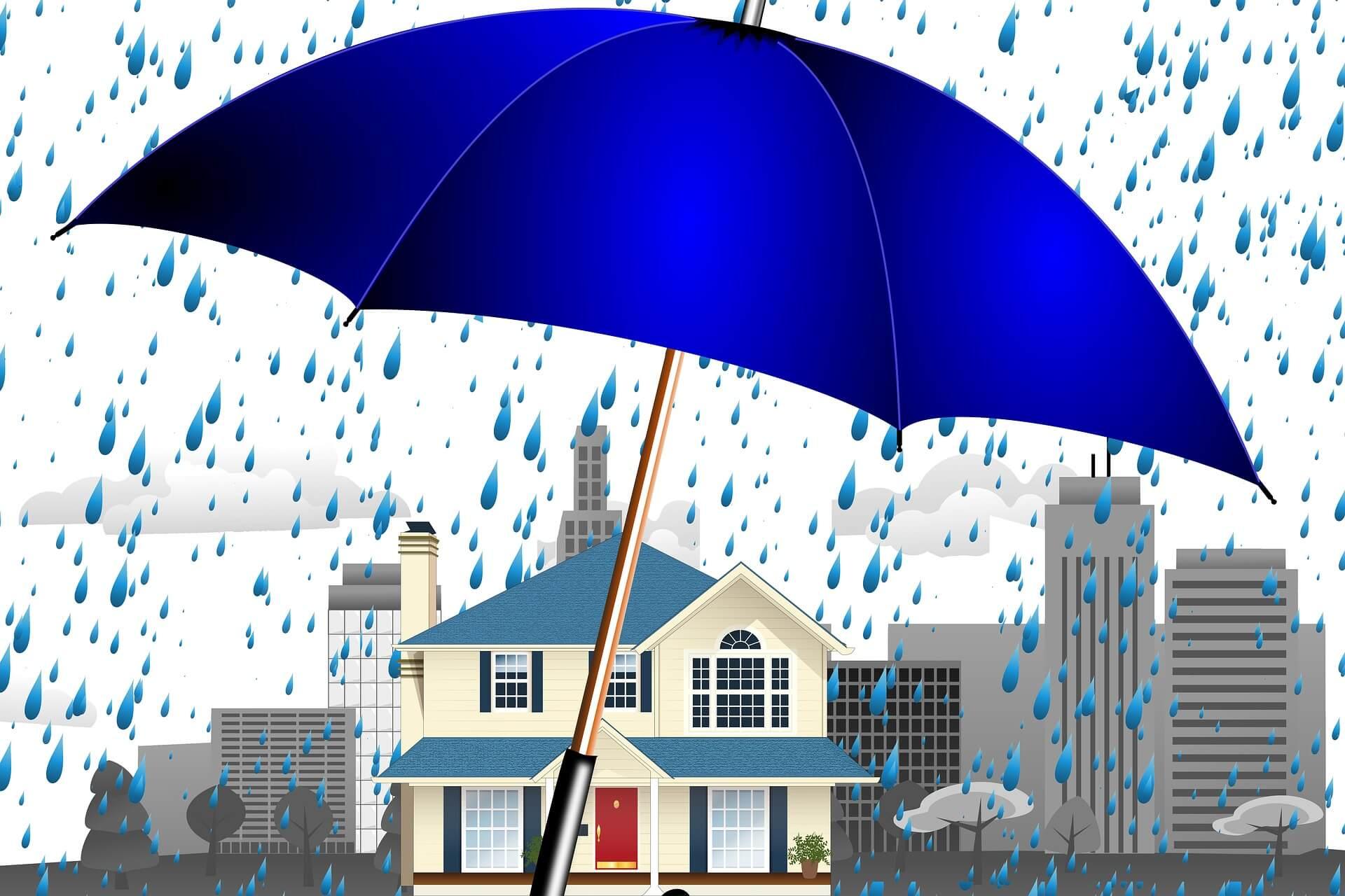 Haus wird durch Regenschirm vor Feuchtigkeit geschützt